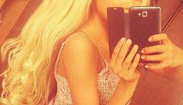 Sexy blonde makes selfie for randomchat