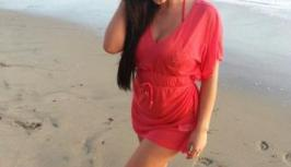 Sexy girl in red dress on the beach